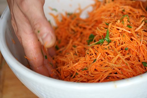stirring carrot salad