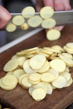 slicing potatoes