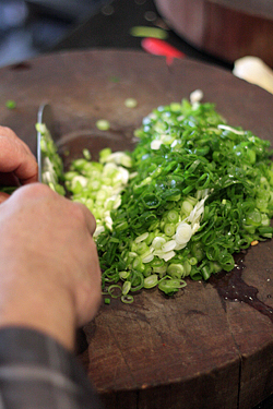 chopping scallions
