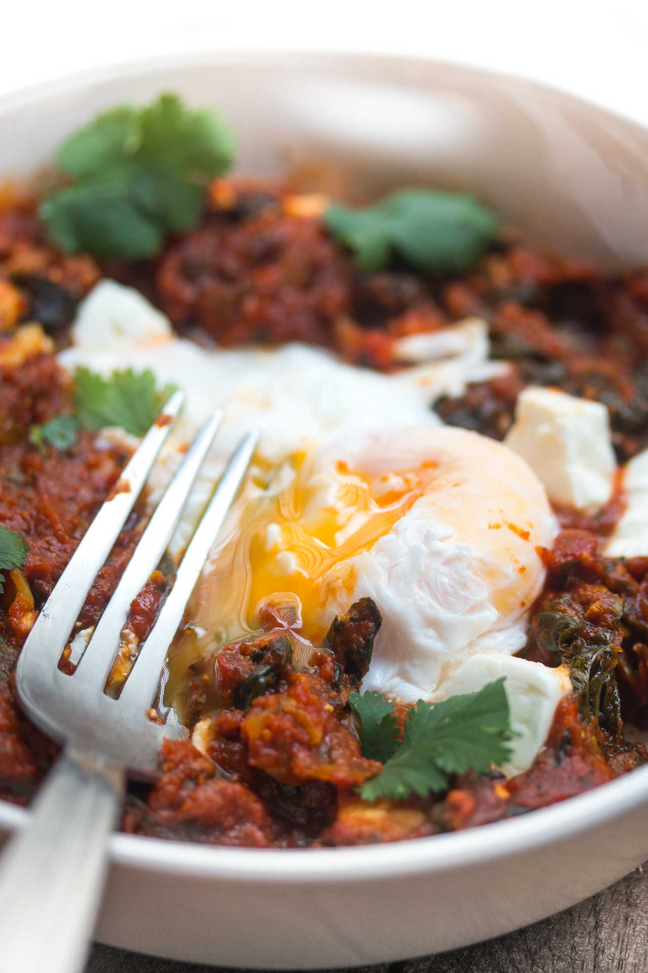 A delicious dish made with eggs cooked in a spicy tomato sauce. Goes well with crusty bread!
