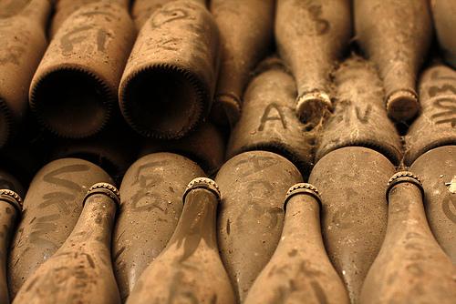 Dusty champagne bottles