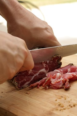 slicing charcuterie