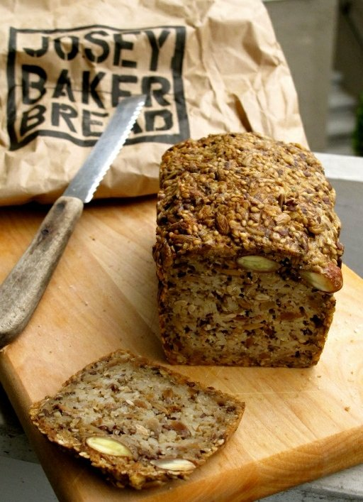 This loaf of bread is easy to make, and packed with nuts and seeds. #glutenfree