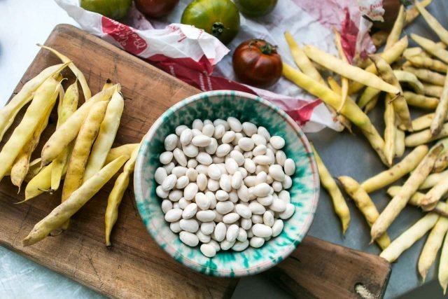 Shelling beans for Tomato salad with basil vinaigrette
