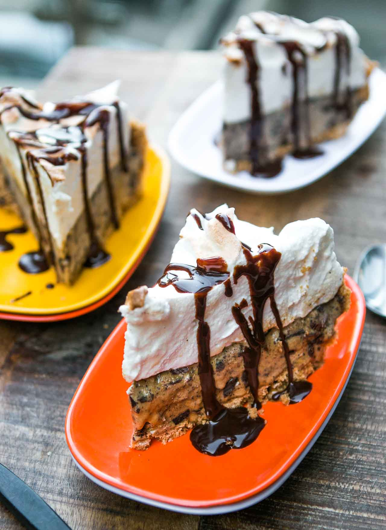 Ice cream pie topped with marshmallows and salted dark chocolate sauce