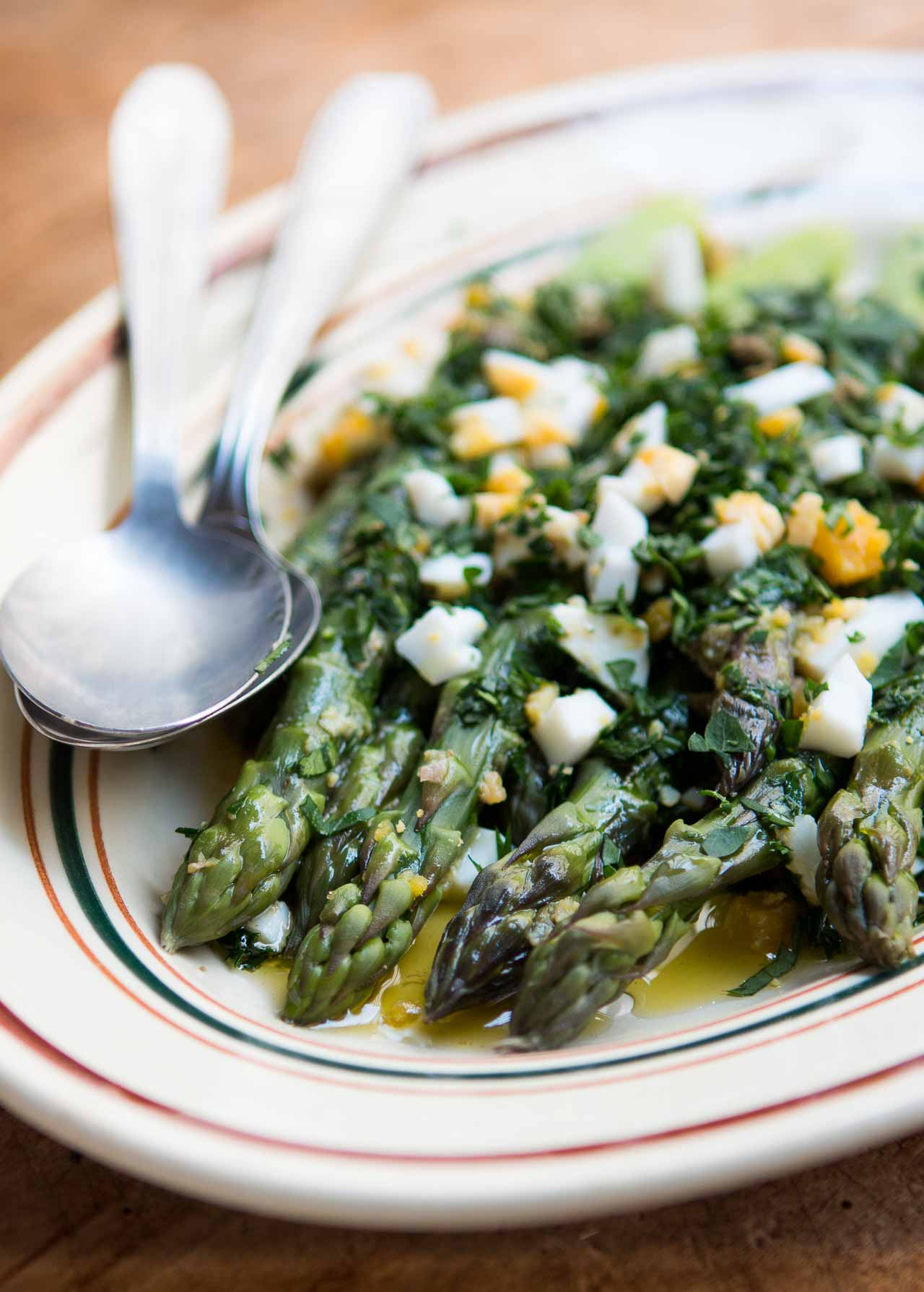 Fresh asparagus with this dish, with a vinaigrette sauce, tangy capers, hard-cooked eggs, and lots of fresh parsley!