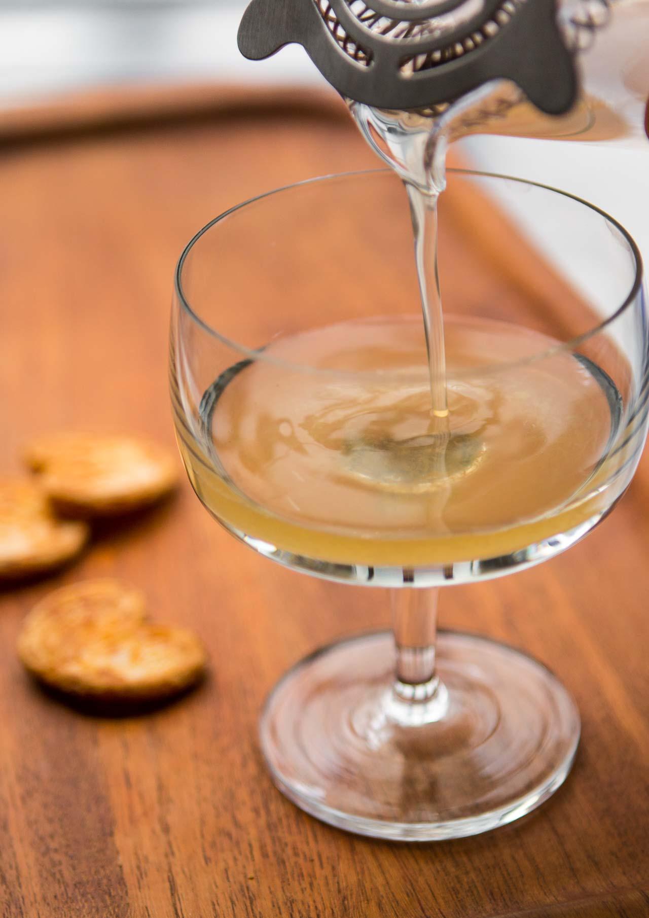 A delicious vintage cocktail with gin, lemon juice and noyau (almond) liqueur